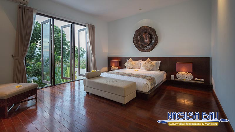 nagisa bali bay view villas bedroom with beautiful scenery